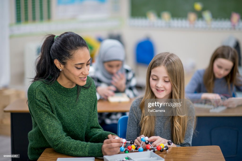 Lehrer mit einem glücklichen Schüler : Stock-Foto