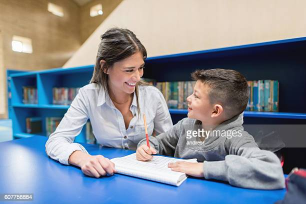 Teacher with a student at the library