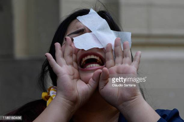A teacher with an eye patch shouts slogans during a protest against Education Minister Marcela Cubillos on November 28 2019 in Santiago Chile Violent...