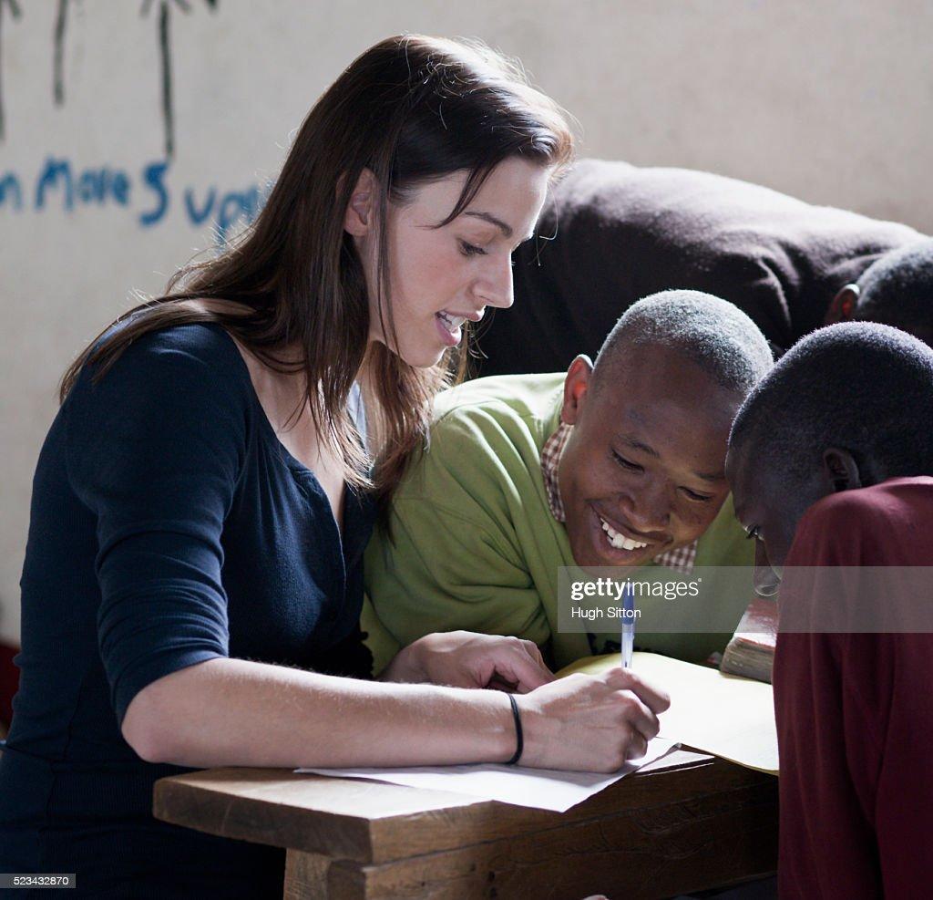 Teacher with boys in school : Stock Photo