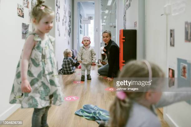 teacher with children in playschool - nursery school child stock pictures, royalty-free photos & images