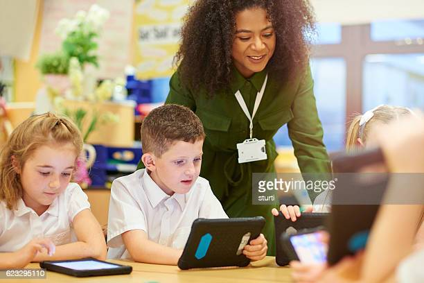 teacher with digital ready students - classroom stock photos and pictures