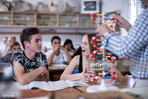 Teacher with DNA model and students in class