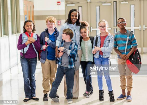 teacher with elementary students and down syndrome boy - elementary age stock pictures, royalty-free photos & images