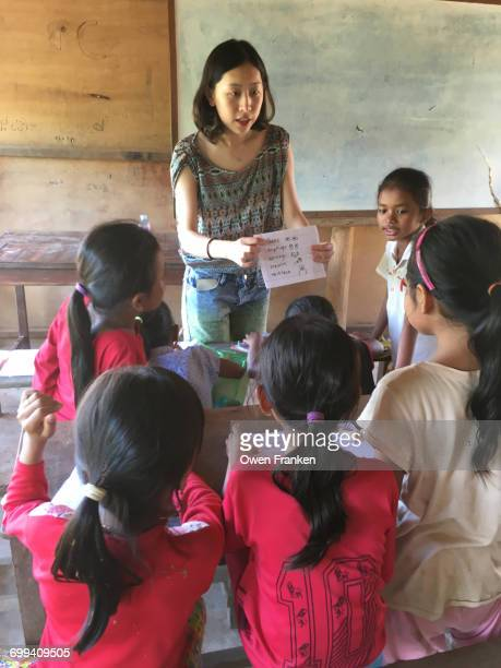 Teacher with girl students, learning English