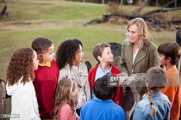 Teacher with group of children at zoo