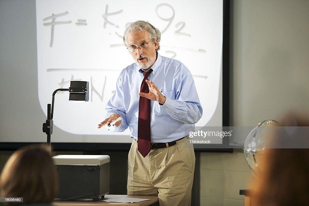 Teacher with overhead projector : Stock Photo