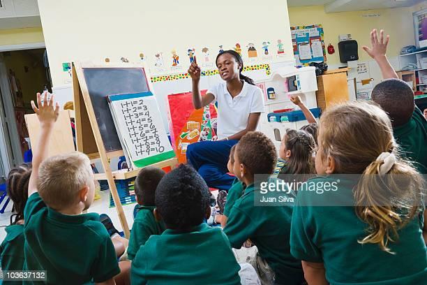 Teacher with preschool students in classroom