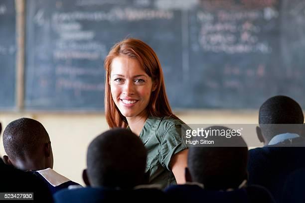 teacher with school children, kenya - hugh sitton stock pictures, royalty-free photos & images