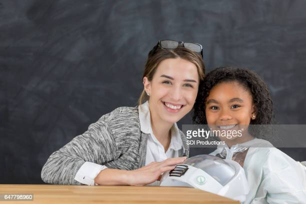 Teacher with student during career day