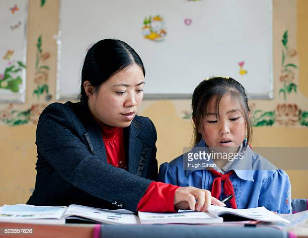teacher with student girl. sapa. vietnam - hugh sitton stock-fotos und bilder