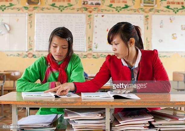 teacher with student in classroom. sapa. vietnam - hugh sitton stockfoto's en -beelden