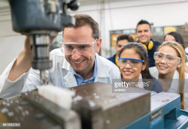 teacher with students in a mechatronics class - mechatronics stock pictures, royalty-free photos & images