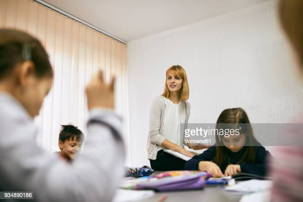 Teacher with students in class