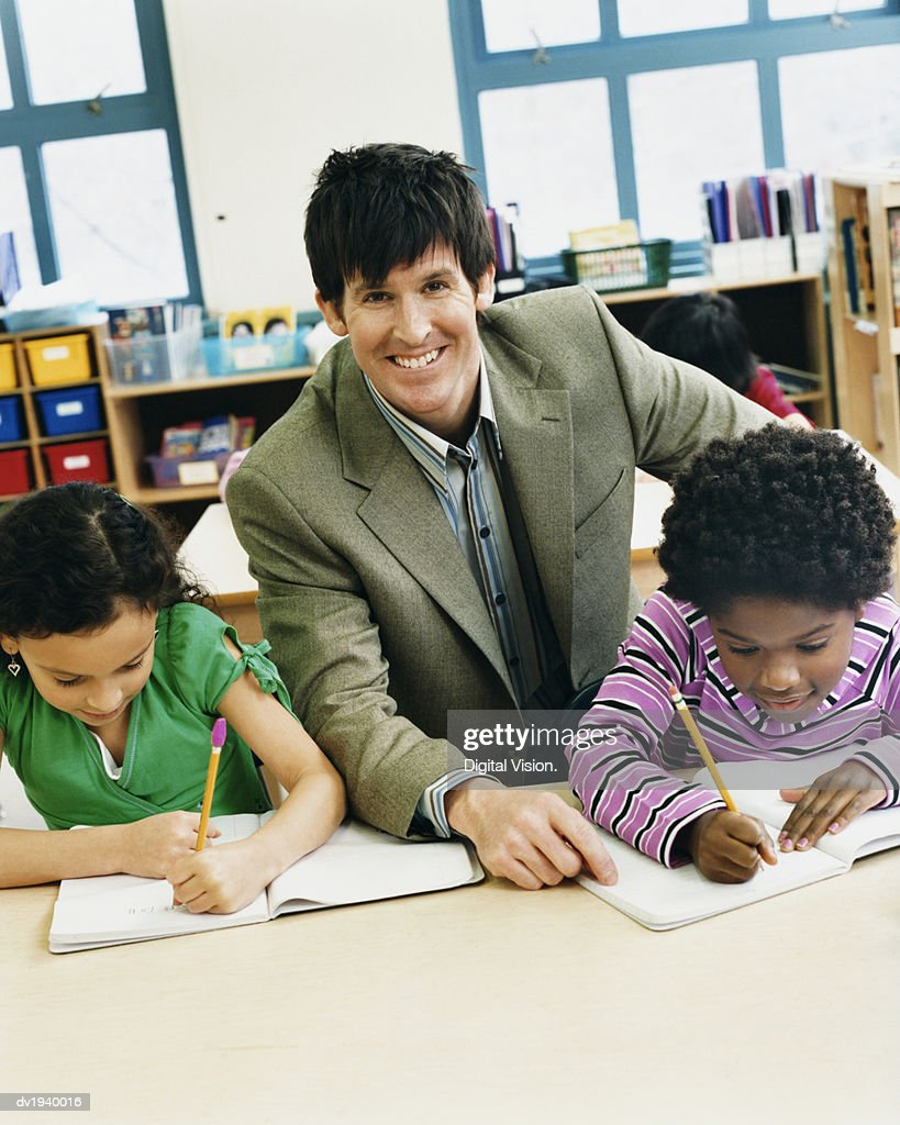 Teacher With Two Schoolgirls Studying : Stock Photo