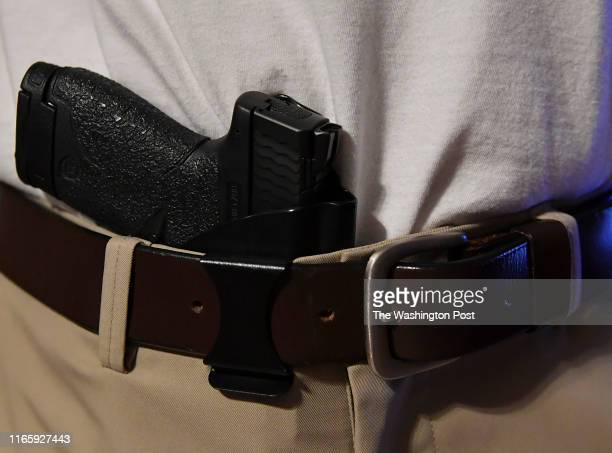 Teacher with Warren Local Schools prepares for the first day of school armed with a handgun in the waistband on August 21, 2019 in Washington County,...