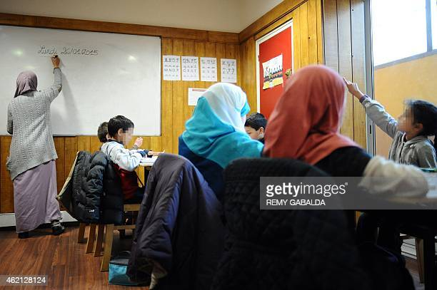 KHADIGE A teacher works with children in a muslim private school in the district of Le Mirail in Toulouse on January 23 2015 AFP PHOTO / REMY GABALDA