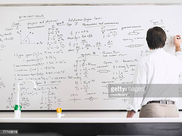 teacher writing on whiteboard - mathematician stock pictures, royalty-free photos & images