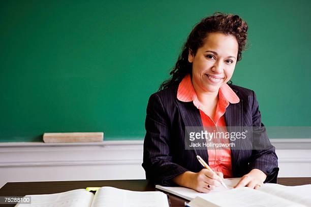 Teacher writing, smiling, portrait