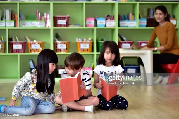 Teachers and children  having fun on learning  in an international school .