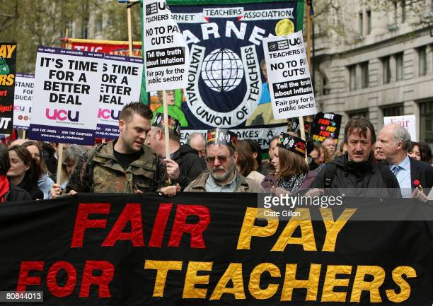 Teachers and civil servants march on Aldwych as they campaign for better pay during a one day strike on April 24 2008 in London England Hundreds of...
