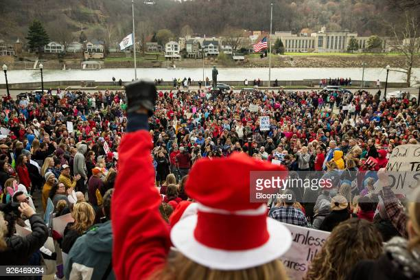 Teachers and demonstrators hold signs and chant during a rally outside the West Virginia Capitol in Charleston West Virginia US on Friday March 2...