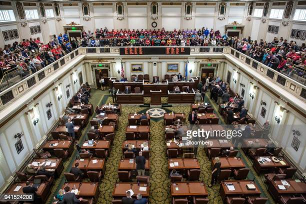 Teachers and demonstrators sit in the upstairs gallery inside the Oklahoma State Capitol building in Oklahoma City Oklahoma US on Tuesday April 3...