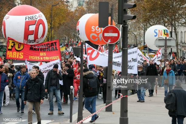 Teachers and educationalists hold banners signs and flags against educational cuts as they demonstrate during a nationwide strike to denounce the...