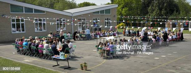 Teachers and staff at the Bucklebury Church of England Primary School Royal wedding party in the school playground