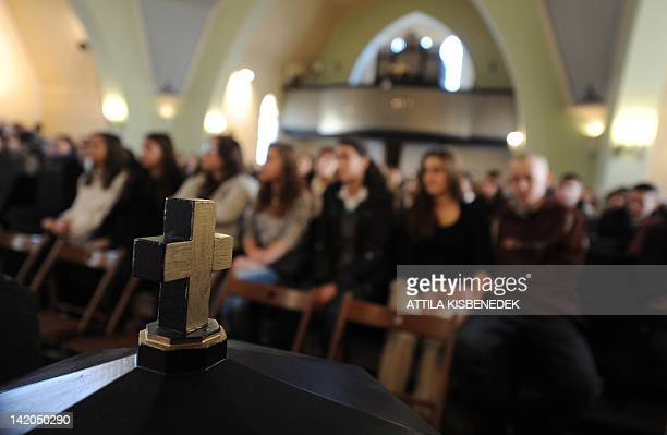 Teachers and students of the Sztehlo Gabor school listen to a parable at the local Evangelical church in Budapest's 18th district on March 12 2012...