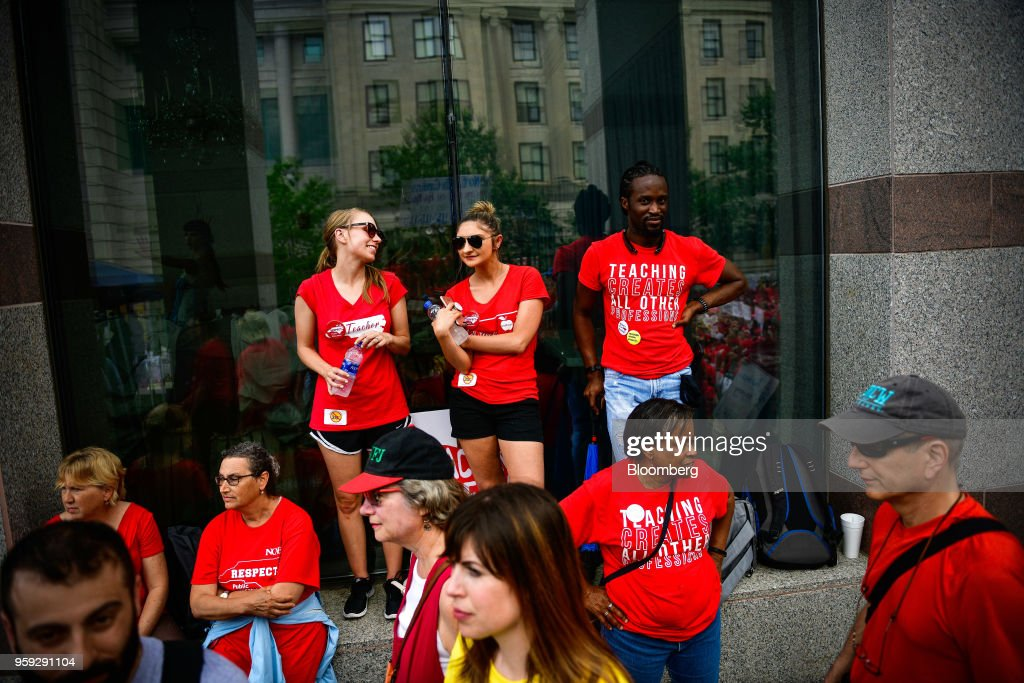 Teachers and supporters attend a 'March For Students And Rally For Respect' protest in Raleigh, North Carolina, U.S., on Wednesday, May 16, 2018. At least 29 North Carolina public school districts serving 865,000 students will close their doors asteachers walk out in the fifth large-scale demonstration in less than three months in states with Republican-led legislatures, most of them organized on the internet in places where unions are weak. Photographer: Charles Mostoller/Bloomberg via Getty Images