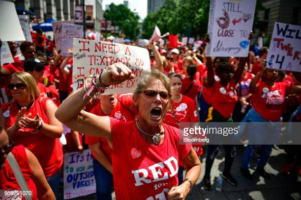Teachers and supporters hold signs and shout slogans during a 'March For Students And Rally For Respect' protest in Raleigh North Carolina US on...