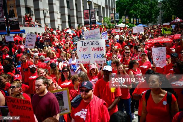 Teachers and supporters hold signs during a 'March For Students And Rally For Respect' protest in Raleigh North Carolina US on Wednesday May 16 2018...