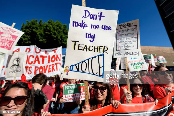 Teachers and supporters of public education march against education funding cuts during the March for Public Education in Los Angeles California on...