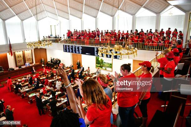 Teachers and supporters stand during a 'March For Students And Rally For Respect' protest at the North Carolina State Assembly on the first day of...