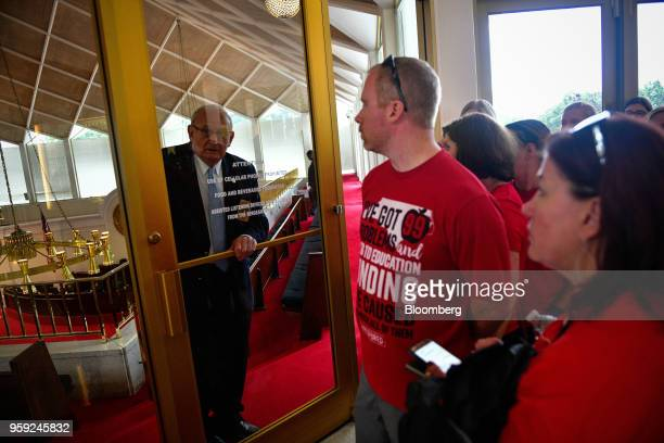 Teachers and supporters wait to enter the North Carolina State Assembly on the first day of the state's legislative session during a 'March For...