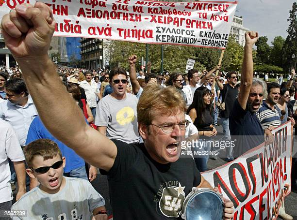 Teachers and university professors shout slogans in central Athens 06 October 2003 About 500 education employees rallied outside the Greek Finance...