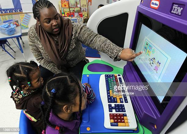 Teacher's assistant Janessa Jackson works with Jada Jean left and Amaya JonesDeJesus in classroom five Mattapan Family Service Center Head Start...
