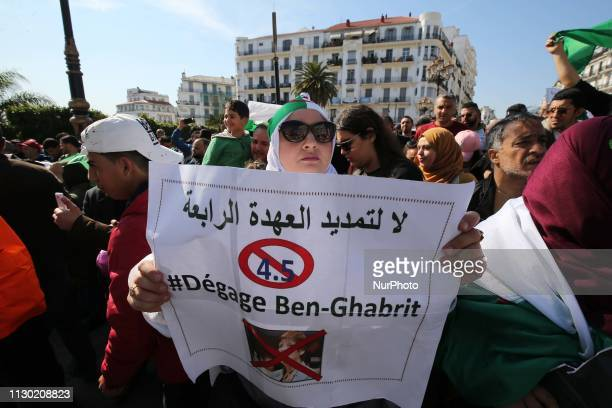 Teachers carry banners and chant slogans during a demonstration Against the extension of President Abdelaziz Bouteflika and demanding an immediate...