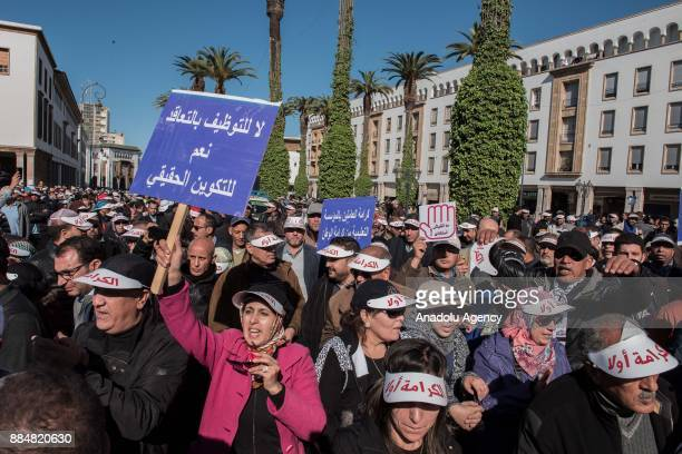 Teachers carry banners as they march during a protest on violence against teachers at the Bab alAhad Square in Rabat Morocco on December 03 2017...
