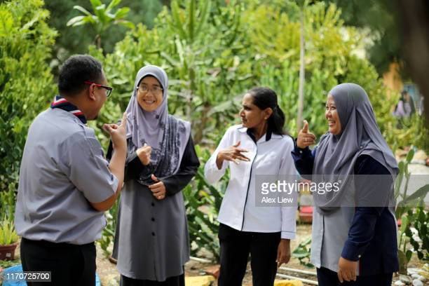 teachers communicate using sign language - sign language stock pictures, royalty-free photos & images