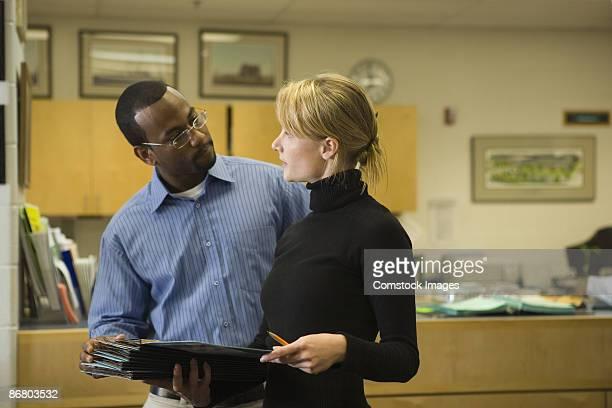 Teachers conversing in office