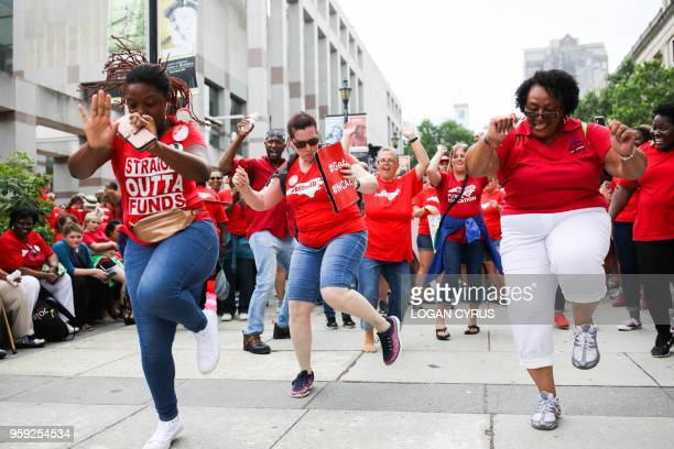 Teachers dance during a protest outside the state capitol in Raleigh North Carolina on May 16 2018 Tens of thousands of educators school workers and...