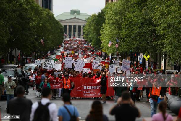 Teachers from across the state of North Carolina march and protest in Raleigh the state capital on May 16 2018 Tens of thousands of educators school...