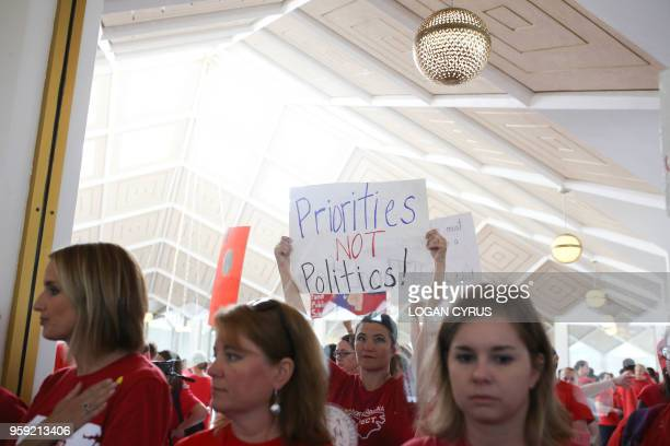 Teachers from across the state of North Carolina march and protest outside the State Capitol building in Raleigh on May 16 2018 Tens of thousands of...