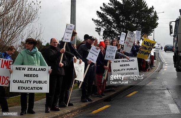 Teachers from Rangitoto College drum up support from oncoming traffic as teachers walked off the job at Rangitoto College at 1pm as industrial strike...