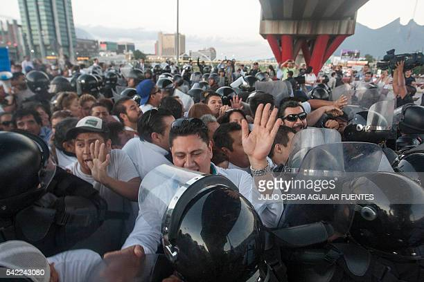 Teachers from the state of Nuevo Leon are confronted by law enforcement officers during a protest march in solidarity with colleagues from Oaxaca...