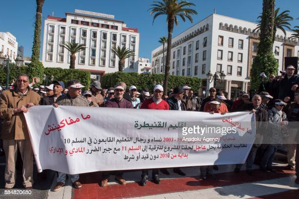 Teachers hold a banner during a protest on violence against teachers at the Bab alAhad Square in Rabat Morocco on December 03 2017 Hundreds of...