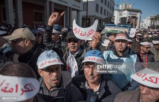 Teachers march during a protest on violence against teachers at the Bab alAhad Square in Rabat Morocco on December 03 2017 Hundreds of teachers...