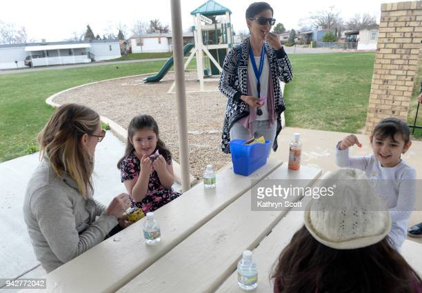 Teachers Nikki Kohler center and Leigh GriggsWilson left take the students left to right Sofia Lucero Anai Orona and Lilhyann Ortiz outside for snack...
